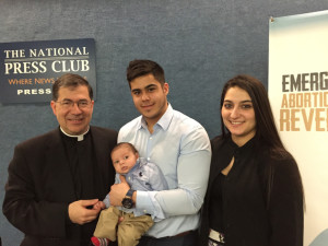 Father Pavone poses with young family following news conference in Washington on RU-486 reversal protocol